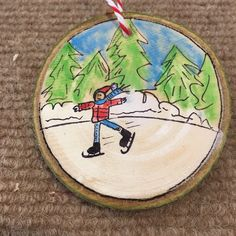 Cute child ice skater wood sliced ornament.