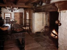 Sweet hearth for using dutch ovens, nice table too!