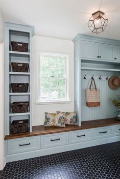 Stunning blue mudroom built-in shelves and cabinets surrounding a small window l. Stunning blue mudroom built-in shelves and cabinets surrounding a small window lighting up the room Stockholm Design, Mudroom Laundry Room, Mud Room Lockers, Mudroom Cubbies, Mud Room Garage, Garage To Living Space, Laundry Room Layouts, Laundry Room Remodel, Laundry Room Cabinets