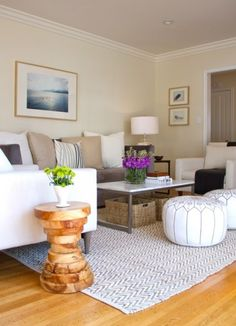 Suzie: Turquoise LA - Butter yellow walls paint color, white modern chairs, white & gray ...