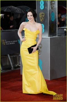 Andrea Riseborough in a Vivienne Westwood dress, Brian Atwood shoes, a Swarovski clutch, and De Beers jewelry.