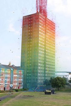 A highrise in Scotland, about to be demolished, is used for a spectacular display of colours, using paint and explosives