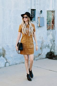 Rock a super soft tan suede dress with a retro bohemian vibe and stay ahead of the trends by expertly pairing this refined texture with classic black.