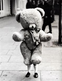 Boy holding very large teddy bear.