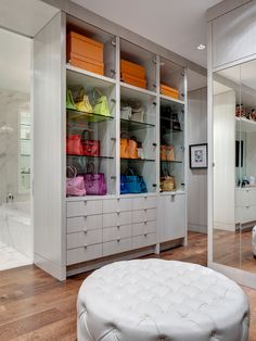 How awesome would it be to have a built-in to display your entire purse collection in your walk-in closet? Gorgeous!