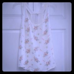 LC Lauren Conrad floral tank Size L, worn a few times, very flowy nice fit, cross back tank top, a little sheer, super cute....ask me anything! LC Lauren Conrad Tops Tank Tops