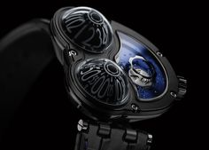 This is something that doesn't happen to often... Two of my favorite watch brands joined forces. Max Busser invited Stepan Sarpaneva to create his version of the MB&F Horological Machine 3 Frog, resulting in the Moonmachine!  Stepan Sarpaneva is well known for his signature moon phase/face. It featured on his Korona K3 Black Moon, can be admired on the Black Moon iPhone App and on several of his newer models like the recent Korona K3 Nothern Stars. And Max Busser is of course well-known for…