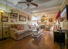 The living room of this cozy cottage is warm and inviting and ready for a new owner.