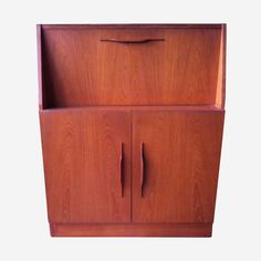 Gorgeous drop fronted cabinet that would easily look great with a turntable atop and vinyl records in the cupboard! Macrob Brand, Made In Australia around the 1960's.