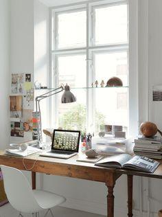 wood desk, inspiration wall & bright light