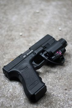Glock 17 with flashlight/ this is the one Loading that magazine is a pain! Excellent loader available for your handgun Get your Magazine speedloader today! http://www.amazon.com/shops/raeind