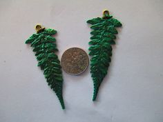 2 Beautifully Detail Ferns painted Lush Green for Jewelry Making. $3.65, via Etsy.