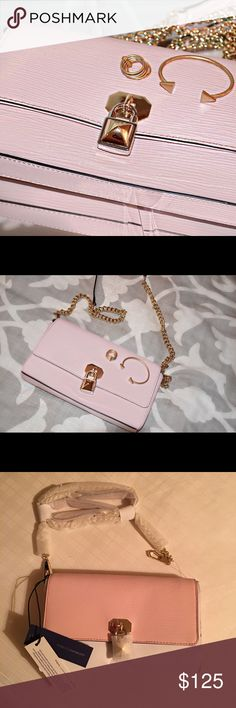 """NWT - Rebecca Minkoff light pink cross body Rebecca Minkoff baby pink """"Lane"""" cross body. The last 2 pictures are taken in off night but to show the tags and wrapping still attached! NWT! Perfect condition, never worn/used! I have 2, so letting go of one! Love this bag!! Rebecca Minkoff Bags Crossbody Bags"""