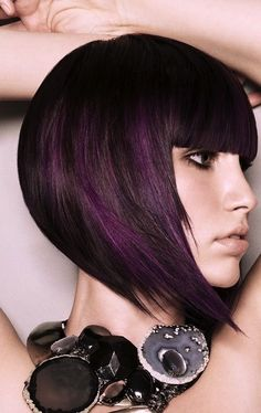 Fun Hair Color: Black hair with a subtle hint of purple! Read: 10 Top Trending Funky Hairstyles #FunkyHairStyles