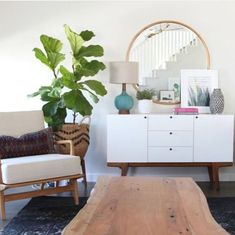 Love the mirror/console table/accent chair with pillow...the coffee table is a little too organic and don't care for the rug or planter that holds the plant..Also, like the overall styling on the console table