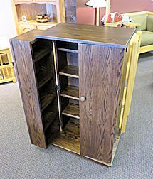 "Amish built media cabinet crafted from Oak with a dark finish.  Doors open to sit against the sides allow for viewing at a glance.  Adjustable shelving will accommodate lots of different sized items.  This is a great addition and storage option for any living/family room!  (One currently available)  Closed dimensions:  45 1/4"" H x 24 1/4"" W x 15"" D  Opened dimensions:  45 1/4"" H x 44 3/4"" W x 15"" D"