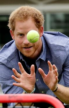 Prince Harry catches a ball as he takes part in a skills exercise whilst attending an event to mark the expansion of the Coach Core sports coaching apprenticeship programme at Lord's cricket ground on October 7, 2016 in London, England.