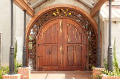 Custom mesquite doors give the venue a historical elegance.  The doors have been hand crafted by the owner of the venue: Robert McCoy of Montgomery, Texas.