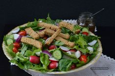 Lebanese bread salad with greens, herbs and crunchy vegetables