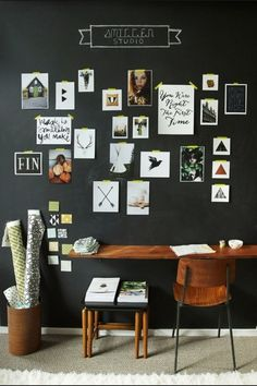 Black wall, white stencil gallery and brown furniture