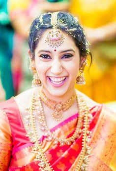 Indian wedding photography. Couple photoshoot ideas. Traditional Southern Indian bride wearing bridal silk saree, jewellery and hairstyle. #IndianBridalMakeup #IndianBridalFashion. Temple jewelry. Jhumkis. Silk kanchipuram sari. Braid with fresh flowers. Tamil bride. Telugu bride. Kannada bride. Hindu bride. Malayalee bride