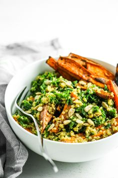 Sweet Potato Quinoa Kale Salad - BEST kale salad. I love the roasted sweet potatoes and the citrus miso dressing. I add this to meal prep and make for dinner all the time! Vegan.