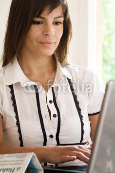 journalist writing at laptop