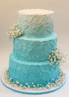 Ombre teal blue textured frosting with fresh baby's breath! We can create this look for you! Visit our site for more info! www,creativeambianceevents.com