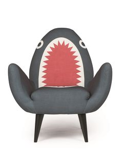 The Rodnik Bank Shark Fin Chair. Add some Shark Chic to your living room with the original Shark Fin Chair, by Philip Colbert's Rodnik Band. £449. MADE.COM