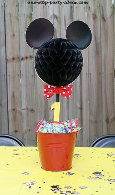 Easy DIY Mickey Mouse themed centerpiece.  See more Mickey Mouse birthday and party ideas at www.one-stop-party-ideas.com