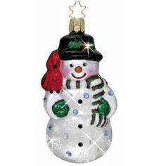 Diamonds in the Snow  Mouth blown, hand painted European glass Christmas ornament Measures approximately 4 1/4  Cheerful snowman with red bird on his shoulder. Decorated with Swarovski