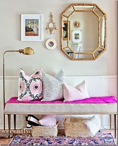 this little entryway space is BEYOND! The color, the wall decor, the pillows, the rug. Yes yes yes and YES!
