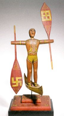 A popular form for whirligigs, this Indian in a canoe from the late 19th century is well carved and painted. Collection of Mary Ingebrand-Pohlad.
