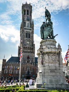 Jan Breydel and Pieter de Coninck statue and Belfry (Belfort) of Bruges in the Grote Markt - Belgium