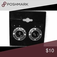 Fashion Earrings The beautiful stud earrings are great for those professional moments. Silver with small diamond like pieces and a black stone in the center. Lady LJ Cosmetics Jewelry Earrings