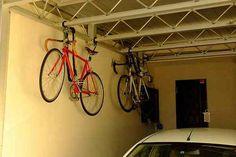 Hanging Bike Storage Design With White Car, outdoor bike storage, bike storage shed ~ Home Design Bike Storage Design, Bike Storage Home, Outdoor Bike Storage, Bike Storage Rack, Vertical Bike Storage, Bike Decorations, Diy Bike Rack, Bike Shelf, Bike Illustration