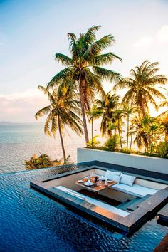 Waterfront dining surrounded by an infiniti pool at the Conrad Resort in Koh Samui
