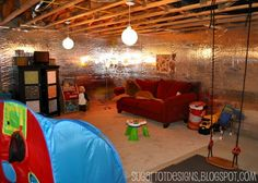 Playroom in an unfinished basement, with a swing.