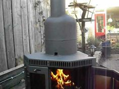 Finished converted wood stove to rocket stove heater - YouTube