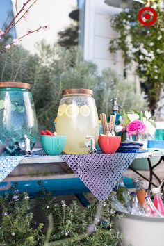 Build a beverage station to make it easy for guests to serve themselves. Start with large beverage dispensers, add punch, lemonade or water to each. Then, garnish each drink with fresh herbs and/or fruit. Keep a small bowl next to each dispenser with the same garnish so guests can dress up their drink.