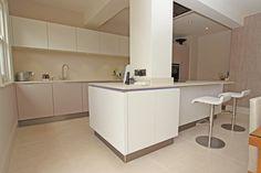 Multi tone kitchen in Cashmere ultra laminate and Cashmere Satin lacquer and Ultra matt laminate white finish