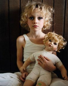 Dakota Fanning, as a young girl, holds her doll!