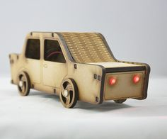 Use a laser cutter to build a toy car that snaps together without glue. In our model we've cut it in 4mm MDF and added head- and stop lights and a battery pack.