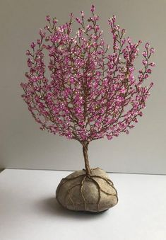 Best 12 Flowering Cherry tree Flower: Hot pink, pink & Ceylon white seedbead mix Base: Stone Size: 6 inch high by 6 inches wide Tree Sculptures Elegantly handmade tree sculptures are skillfully, beaded by hand and weaved together to form a tree with uniq Flowering Cherry Tree, Lilac Tree, Cherry Blossom Tree, Blossom Trees, Wire Crafts, Bead Crafts, Wire Tree Sculpture, Metal Sculptures, Abstract Sculpture