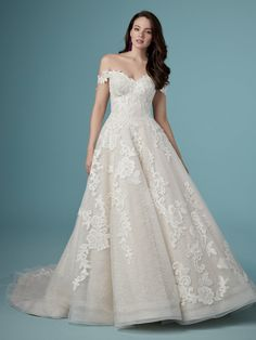 This enchanting princess wedding dress features pockets and textured tulle with horsehair trim along the ballgown skirt. Lace motifs accent the sweetheart neckline and cascade throughout. Finished with pearl buttons over zipper and inner elastic closure. Detachable sheer off-the-shoulder sleeves accented in lace motifs sold separately.