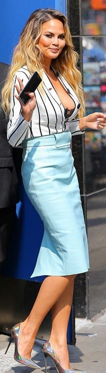 Who made Chrissy Teigen's white stripe top and pumps?