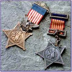 On the left is the Army MOH, on the right is the Navy version /Civil War Medals of Honor. The design is similar in design to the Veteran's GAR medal.