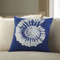 Nautilus Embellished Pillow Cover | A beautiful nautilus embellishment gives this comfy cotton pillow seaside character and charm.