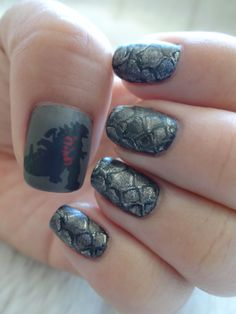 "Godzilla Nail Art. Rarrrr! Painted a base coat of black polish and Ulta ""Mud Pie"" on the thumb. Used Bundle Monster nail plate BM-418 to stamp scales in Miss Kiss ""Chrome Crazy"" with Utla ""Mud Pie"" on top for a layered effect. Topped with a matte top coat. #nailart"
