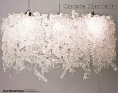 Cascade Chandelier- made from used plasticware.  Cool. Green.